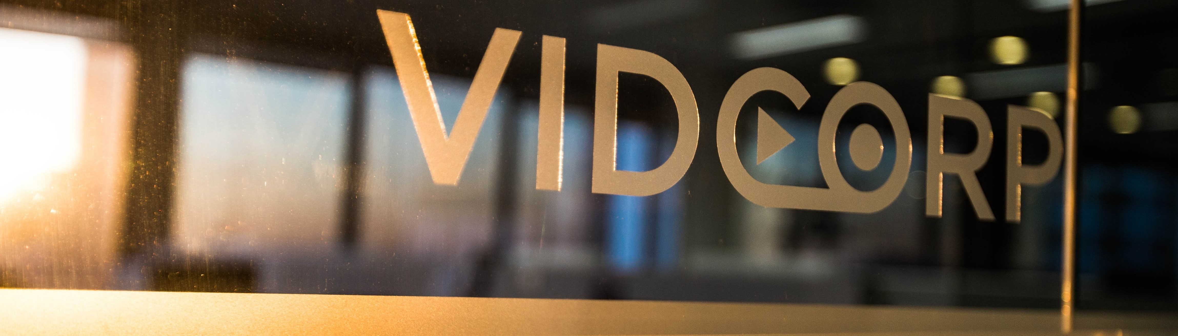 VidCorp logo on glass